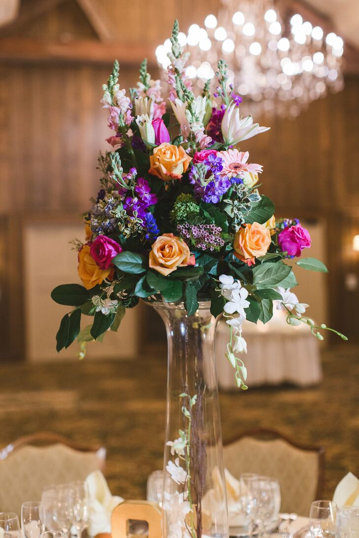 Tall Centerpiece With Purple Orange And Pink Flowers