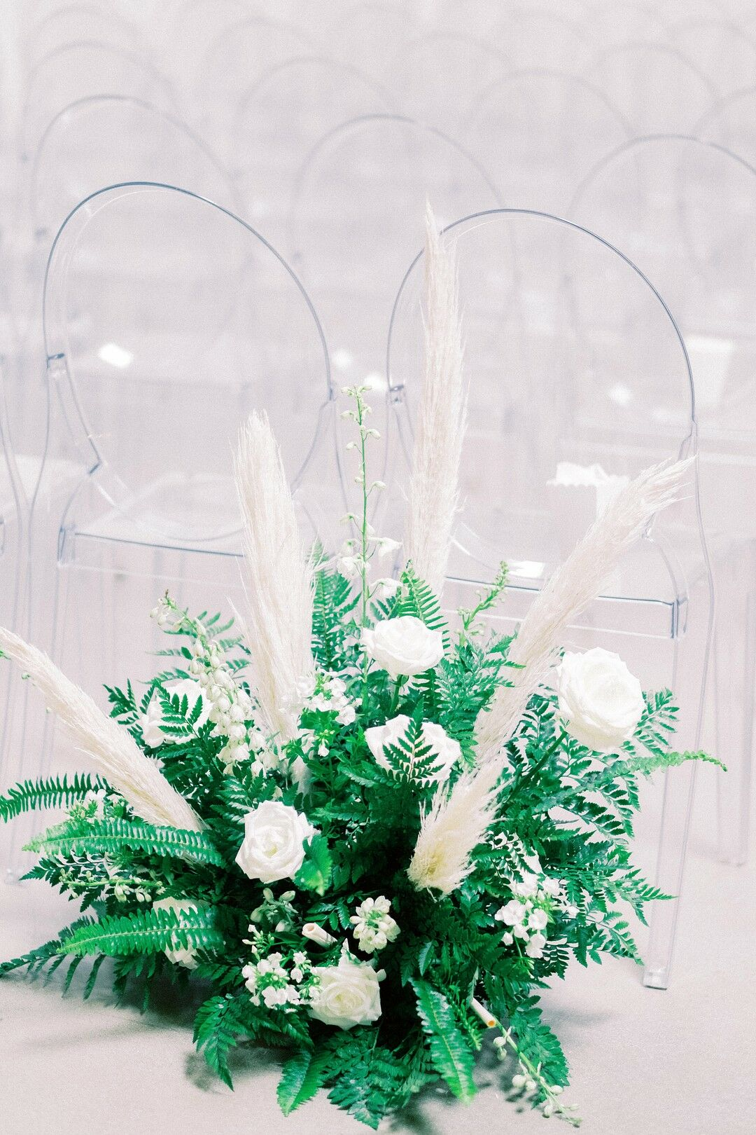 Modern Flower Arrangement With White Roses White Grasses And Leaves
