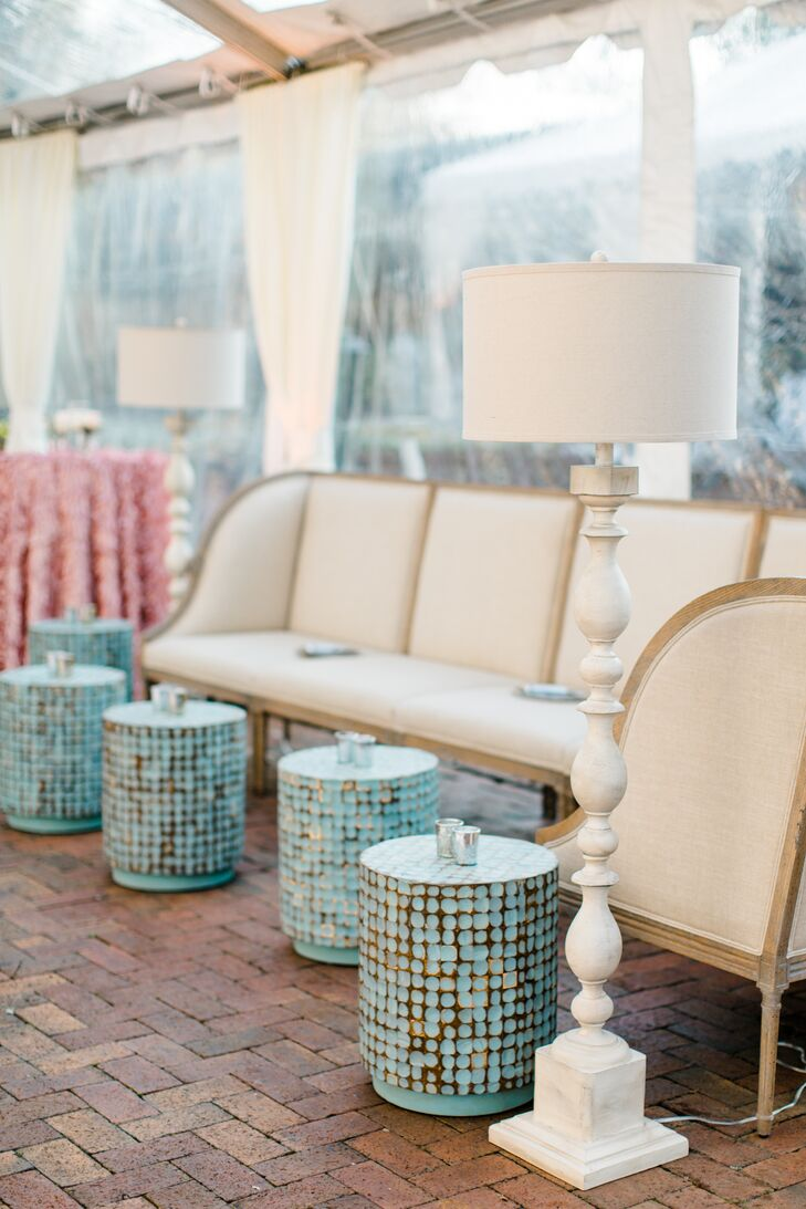 French-style furniture—including tables, lamps, mirrors and sofas—was incorporated to create a lounge atmosphere within the tented reception.