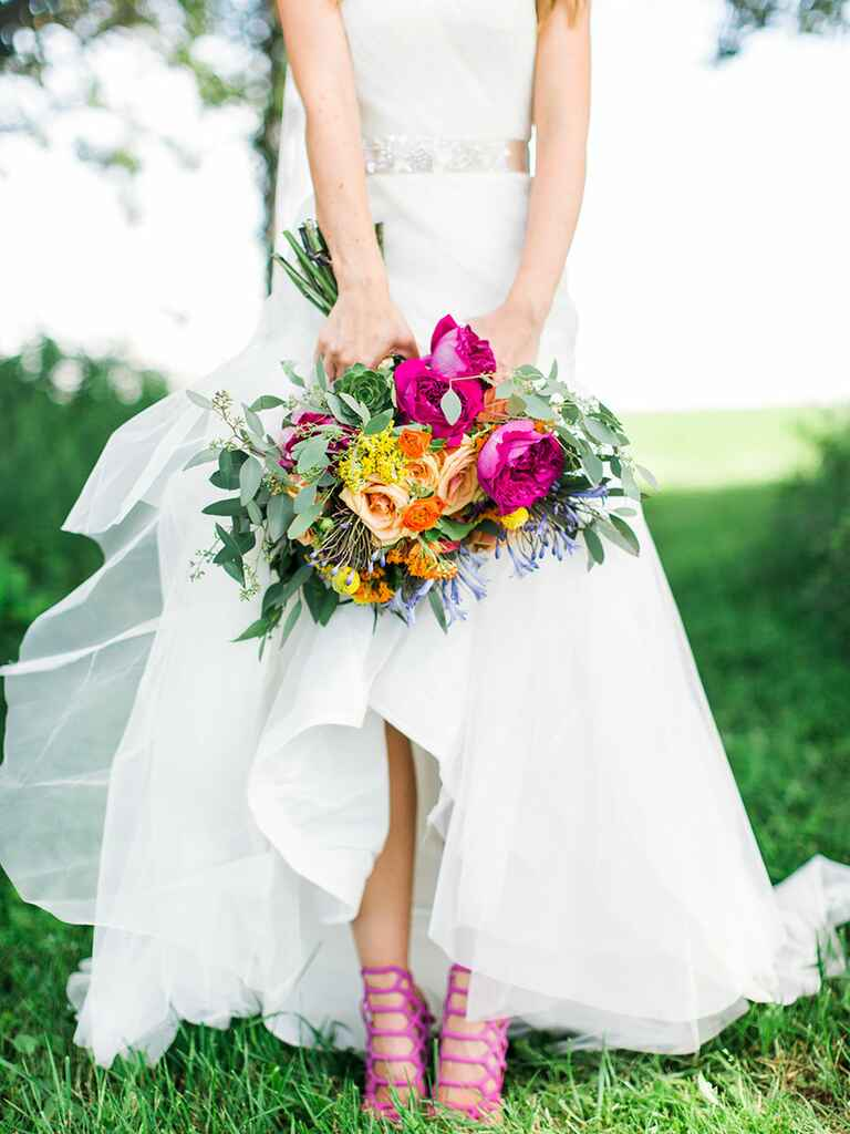 Bride in wedding dress and pink shoes