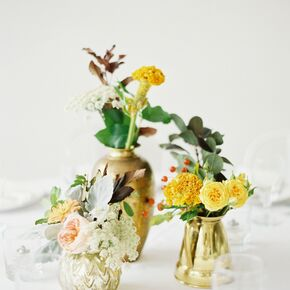 Canary yellow wedding flower arrangements yellow flower centerpiece in metallic bud vases mightylinksfo