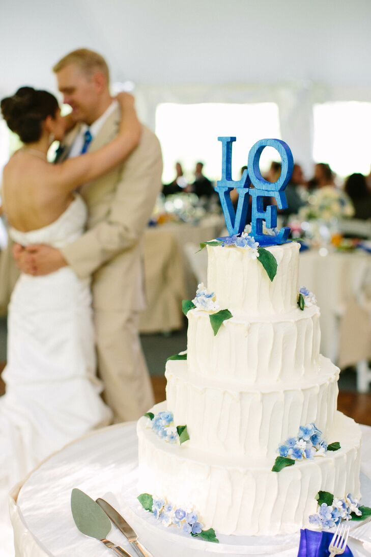 Bright Blue Accents On A Simple White Cake