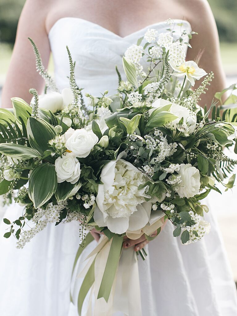 A Bridal Bouquet With Peonies And Ranunculus