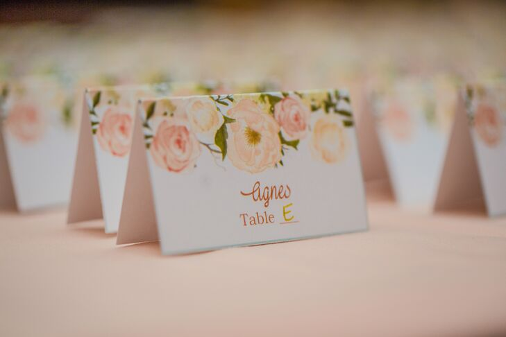 From the ceremony programs to the menus and escort cards, the day-of stationery was designed with a cheerful floral motif. The blush watercolor blooms tied in seamlessly with Nikki Diaz's elegant rose, hydrangea and freesia centerpieces and added a romantic, feminine dimension to the evening's decor.