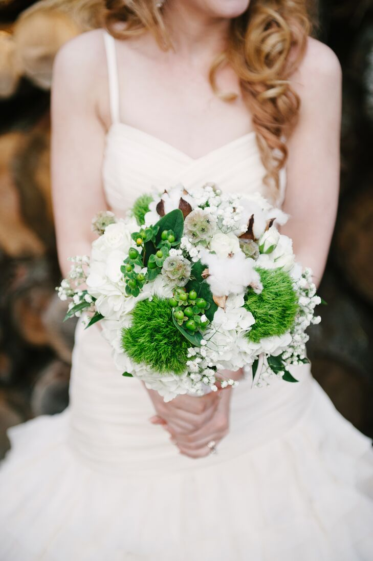 """I was desperate to have cotton in my flowers,"" Taylor says. After advising the help of a family friend, Taylor's bouquet came together using green dianthus, scabiosa pods, white hydrangeas and, of course, cotton."