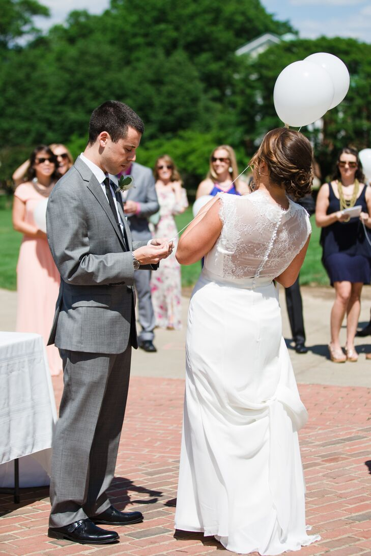 After the ceremony, the bride and groom invited guests to join them outside on campus. They attached eco-friendly notes and strings to white balloons and released them in memory of loved ones who could not be with them.