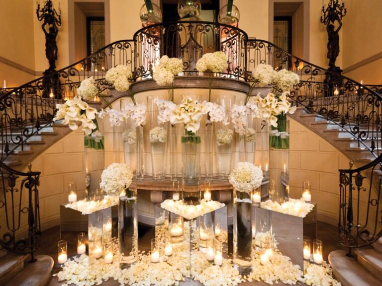Bryan Rafanelli's luxe wedding reception entrance with mirrors and candles