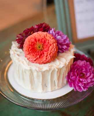 bright single tier wedding cake |<img class=