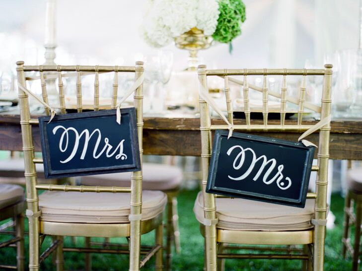 Mr. and Mrs. chairs at a wedding