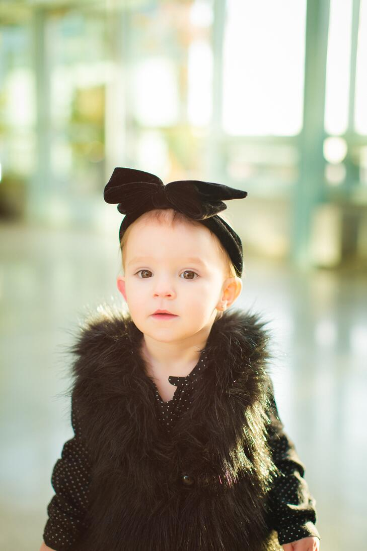 Fashionista flower girl in fur vest