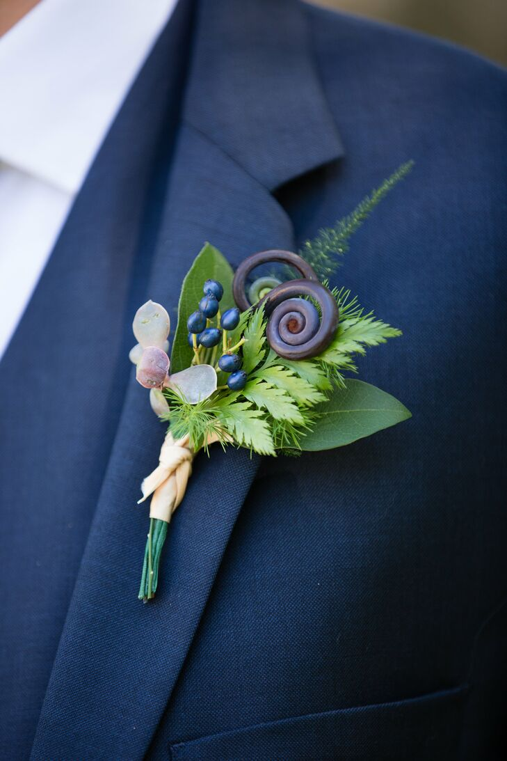 "Playing off the floral's earthy, natural vibe, The Perfect Petal fashioned a boutonniere from ferns, fiddleheads, berries and succulents for Nick to wear on his lapel. ""We both came up with the enchanted forest theme and it really just expanded from there,"" says Kat. ""We envisioned moss, succulents, ferns and very romantic, unusual flowers."""