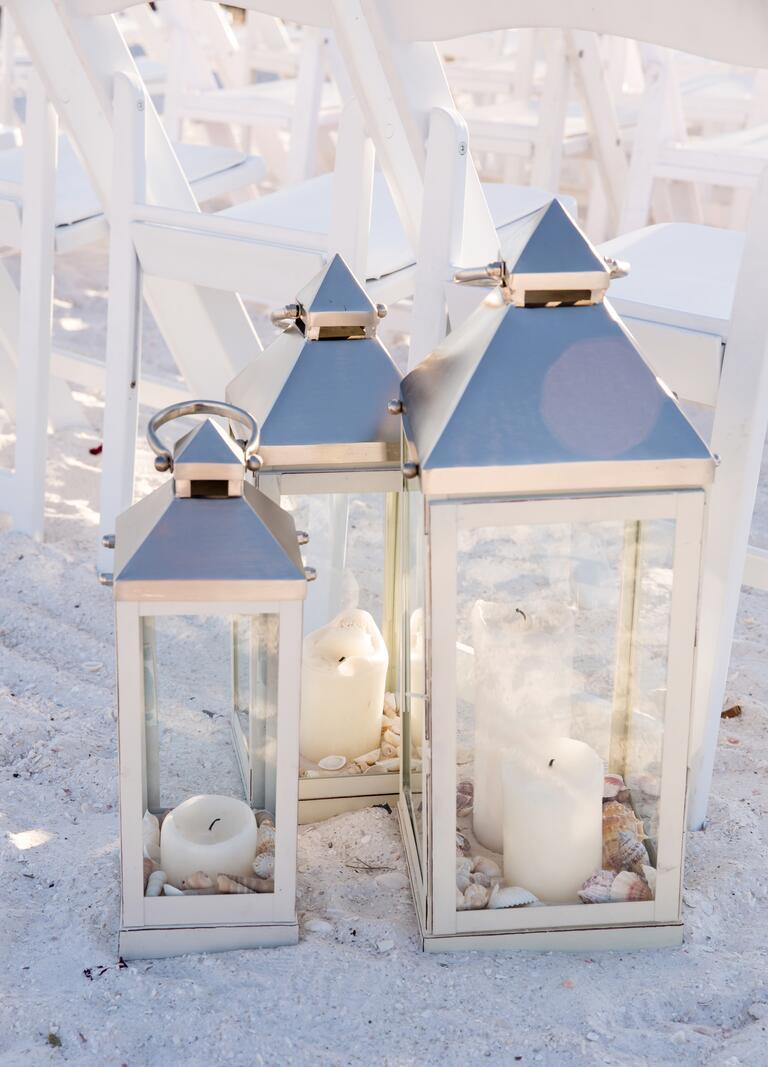 Lantern aisle decor with sand and seashells