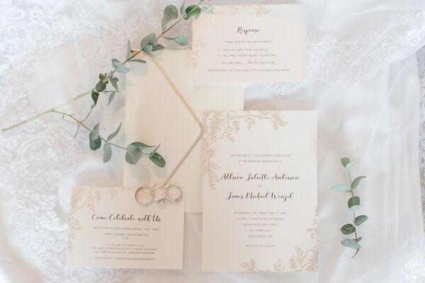 Ivory and Gold Invitations with Floral Motif
