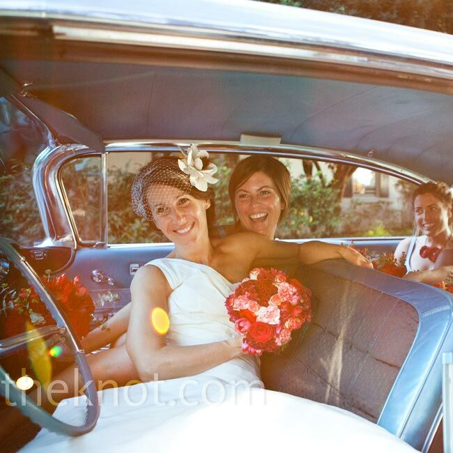 Anissa and her bridesmaids pose for a few shots in a friend's vintage car, which perfectly matched the color of the day.
