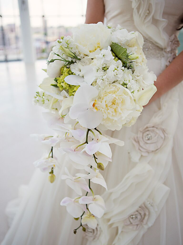 20 romantic white wedding bouquet ideas cascading white bouquet with orchids peonies and sweet pea dhlflorist Image collections