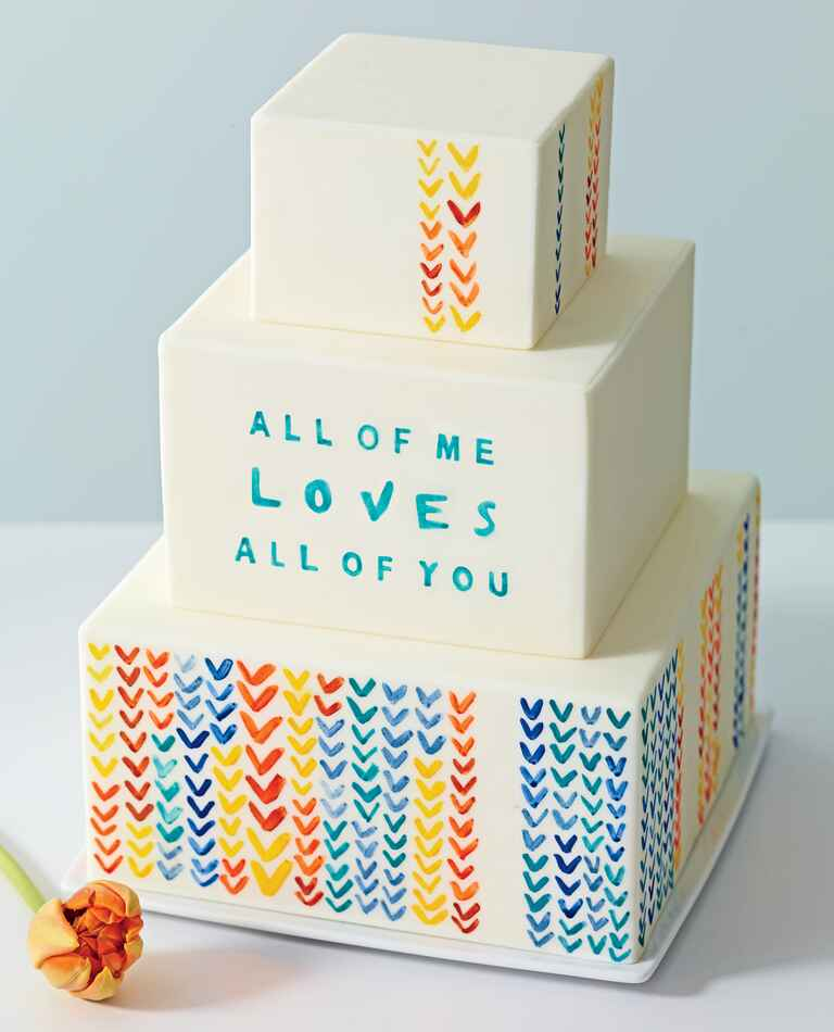Three Tiered Cream Cake With Song Lyrics and Watercolor Hearts