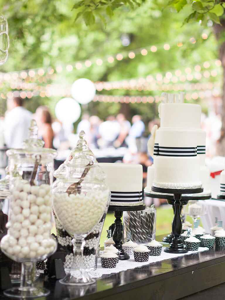 Chic white and black wedding reception candy bar idea