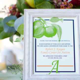 Charity sign at wedding table