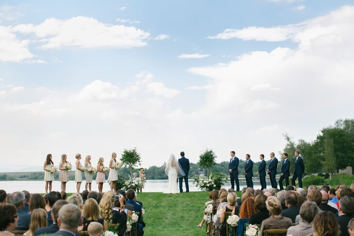 Bryn and Ben exchanged vows in a family friend's yard in Littleton, Colorado. They loved the perfectly manicured grass leading right down to the lake where the Rocky Mountains towered in the background.