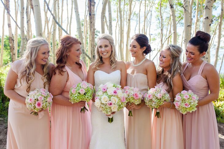 Ashley let the bridesmaids wear blush dress in whatever style they wanted and the house party wear champagne dresses in whatever style they wanted, too.