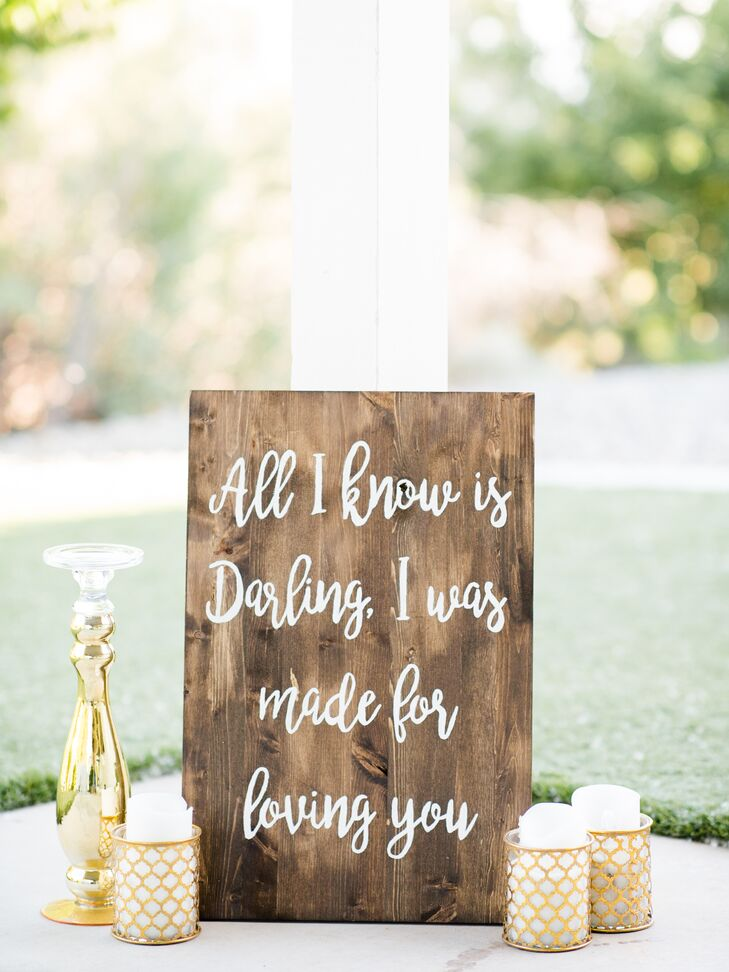 Calligraphed wooden signs were placed throughout the event, adding to the day's rustic, romantic feel.