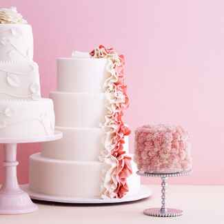 Pink and white tier wedding cake display