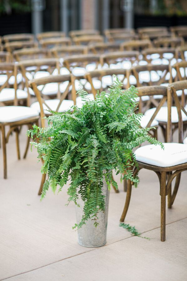 Cascading Fern Aisle Arrangements in Metallic Vases