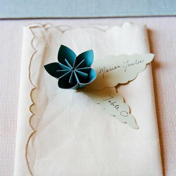 light blue paper flower escort cards