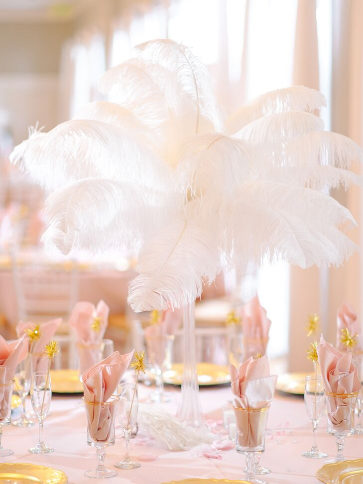 S inspired white feather centerpieces