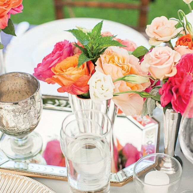 Coral pink and white rose centerpieces