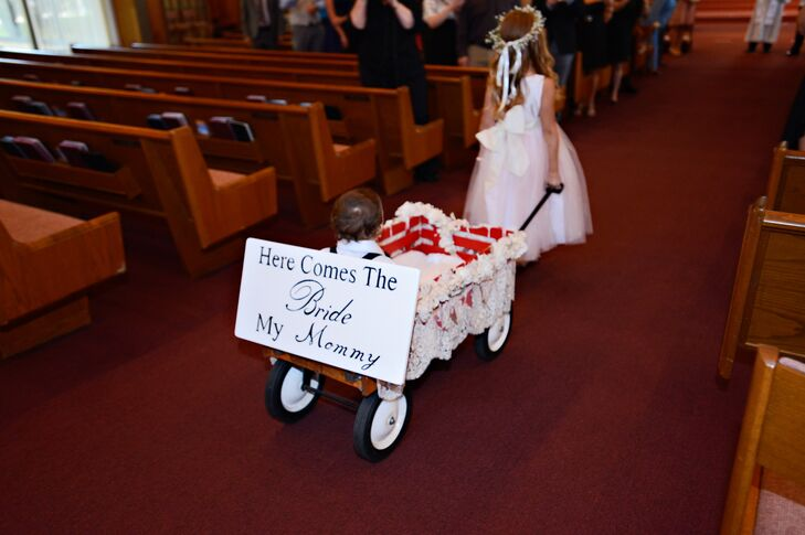 "The couple's son was pulled in a wagon down the aisle with a sign on the back that read, ""Here Comes the Bride: My Mommy."""