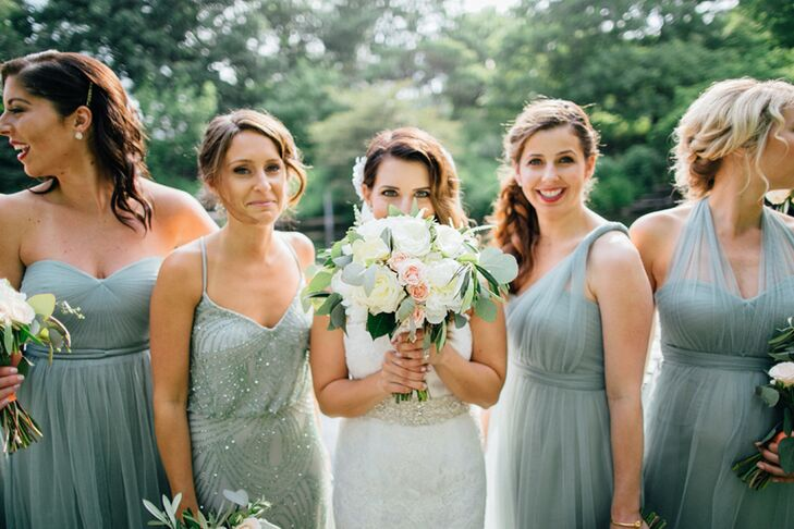 "Lauren's bouquet consisted of white peonies, garden roses, ranunculus, hypericum berries, jasmine, seeded eucalyptus and a flower with sentimental value: gardenias. Gardenias were Lauren's late grandmother's favorite flower (and the flower that her late grandfather always bought his beloved bride), and the only flower Lauren's mom carried down the aisle on her own wedding day. ""I wanted to keep in tradition and have some in my own bouquet,"" Lauren says. Her bouquet was wrapped in lace purchased by her mom on a trip to Italy. A cherub charm—worn on a necklace by Lauren's great-grandmother—was hand-stitched onto the lace, doubling as her something old."