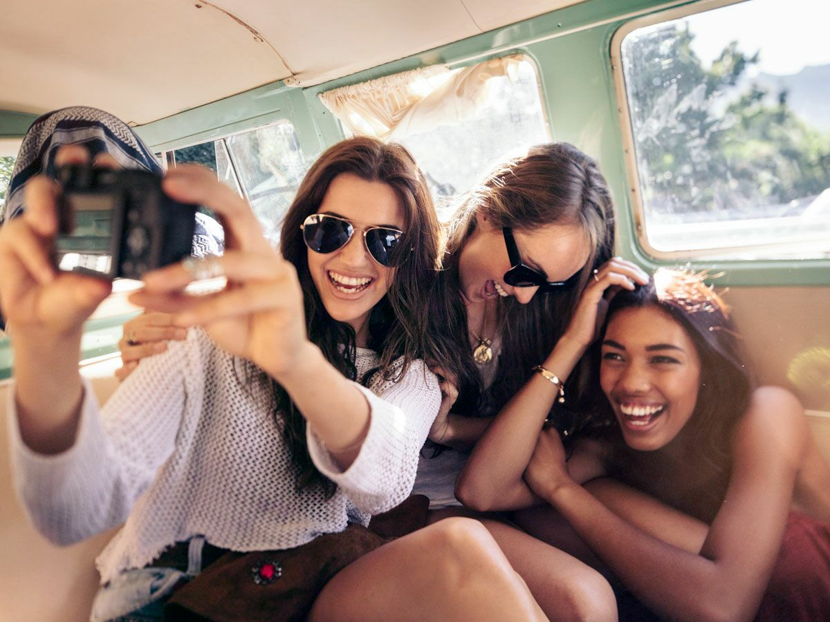 group of women laughing in the car