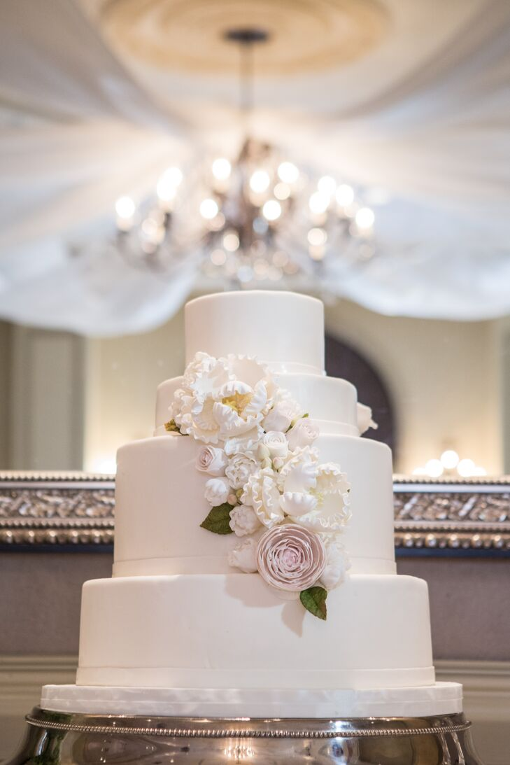 For desert, the guests enjoyed a beautiful white tiered wedding cake decorated with delicate blush sugar flowers.