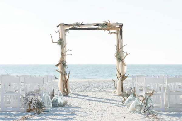 Driftwood Wedding Arch and Seashell Aisle Decor
