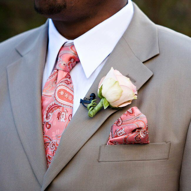 Mark and his six groomsmen wore the same casual summer suit by Calvin Klein with paisley ties and matching Kenneth Cole shoes. They also donned matching paisley handkerchiefs for extra style.