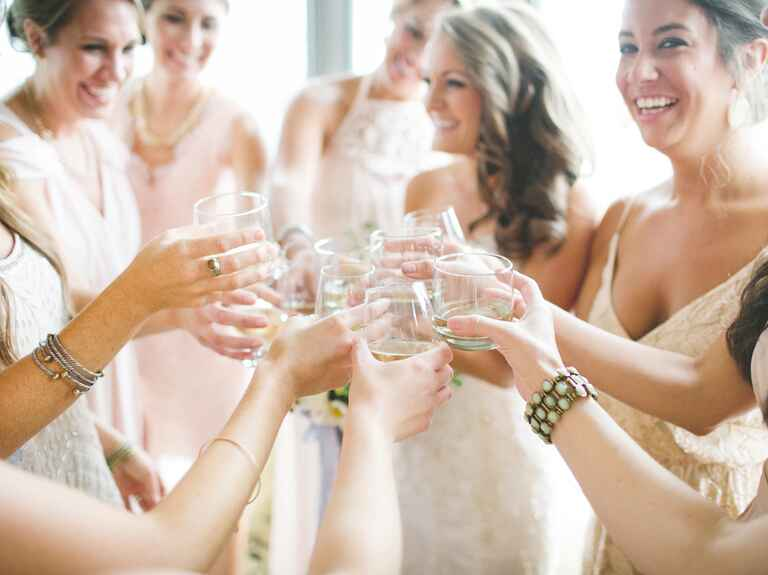 Bride and her bridesmaids giving a toast