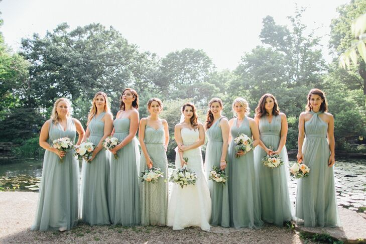 "Seven of the eight bridesmaids wore Annabelle dresses in Jenny Yoo their preferred style. (A stylist from Bella Bridesmaids worked with each woman to find the right fit.) ""I loved how the dress flowed as the ladies walked and, most important, it would be easy to dance in later in the night."" Lauren thought she wanted pale pink but changed her mind when she discovered the sea-glass color. ""I had not seen this color in any bridesmaid dress before,"" she says. The ""lady"" of honor (so much better sounding than ""matron,"" Lauren says) wore a different dress by Adrianna Papell in the same color."