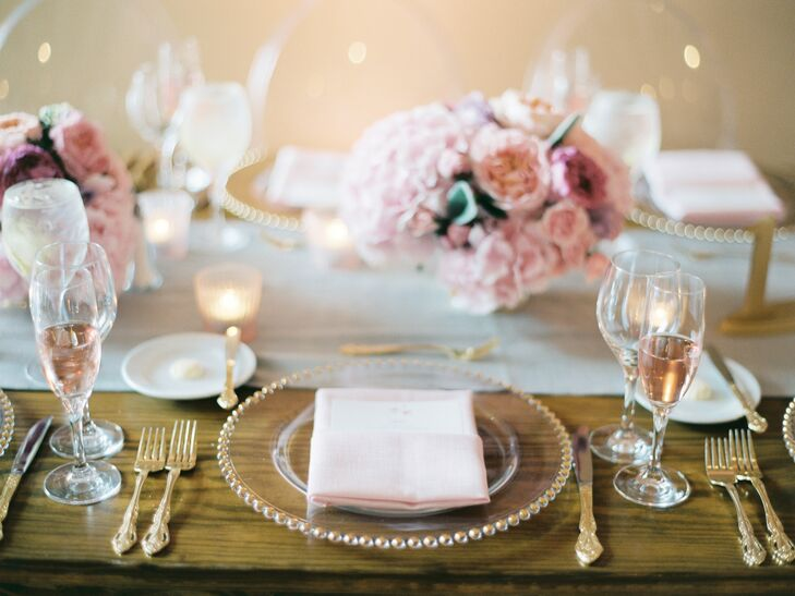 """We had soft pink and gold candles sprinkled throughout the tables, as well as champagne glasses filled with pink champagne as an added décor element.,"" says Kristen. ""The table linens were a soft oatmeal color, our napkins were blush pink, and the silverware and chargers were gold."""