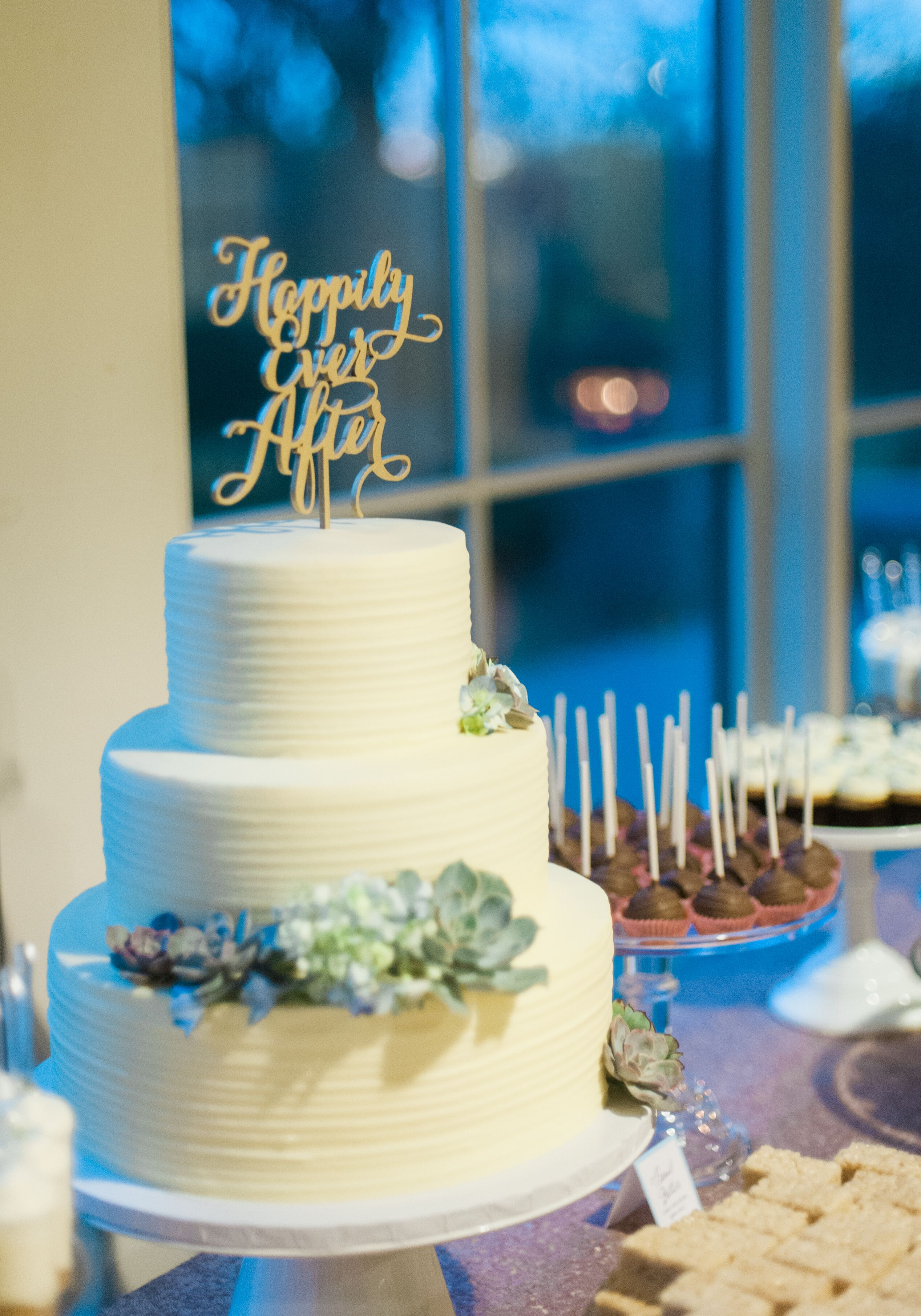 Simple White Wedding Cake With Blue Succulent Accents