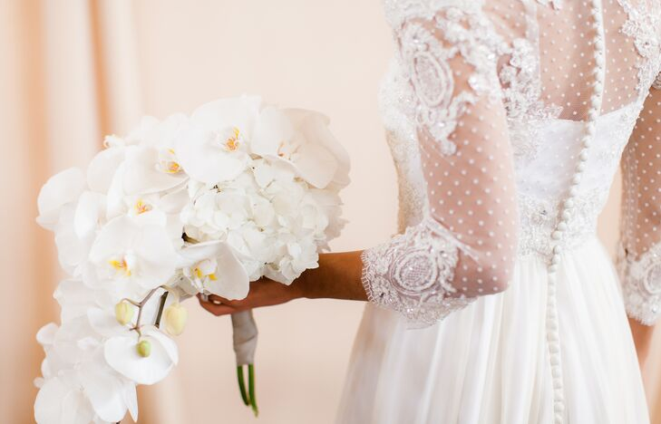 Jenna held on to a white bouquet overflowing with hydrangeas and orchids, going along with the clean look of the wedding day. And the elegant arrangement matched Jenna's white dress perfectly.