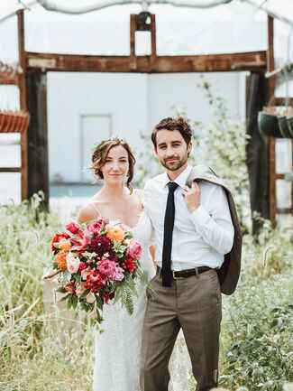 newlyweds in greenhouse