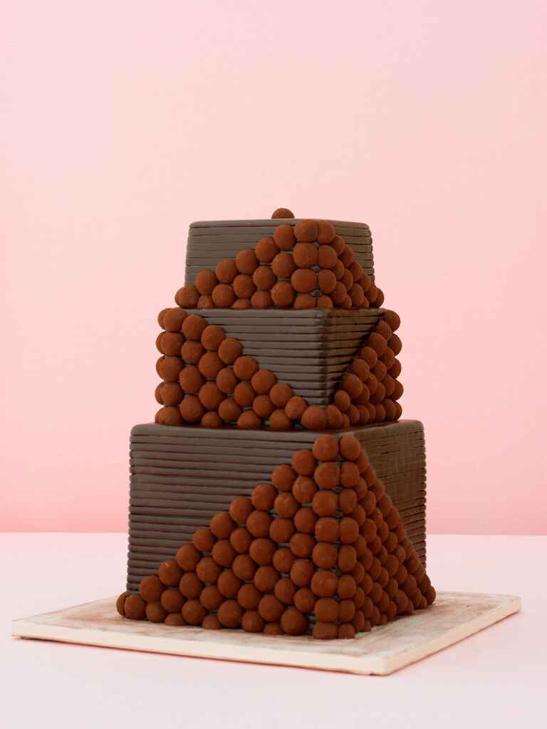 Three-tier chocolate wedding cake with chocolate truffles