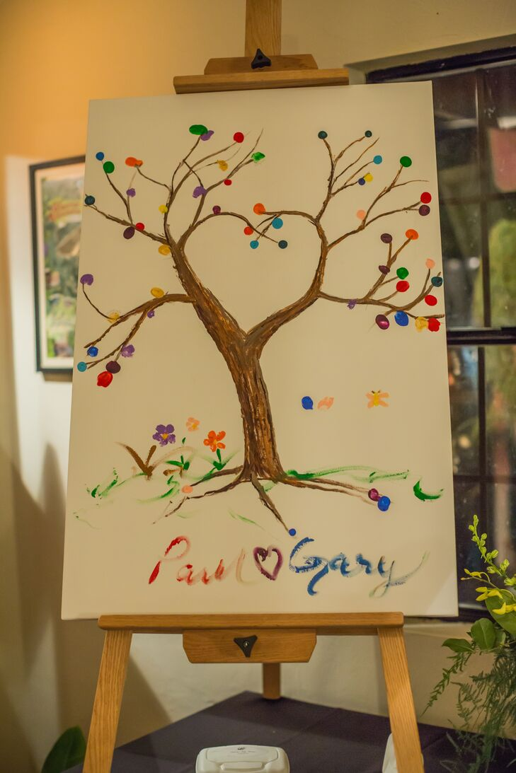 """Paul's groomsmen painted a tree trunk on a medium-size canvas, with the branches done in the shape of a heart,"" Gary says. ""Each guest took their thumb and dipped it in washable colored paint, then pressed it onto the canvas that resembled tree leaves."""