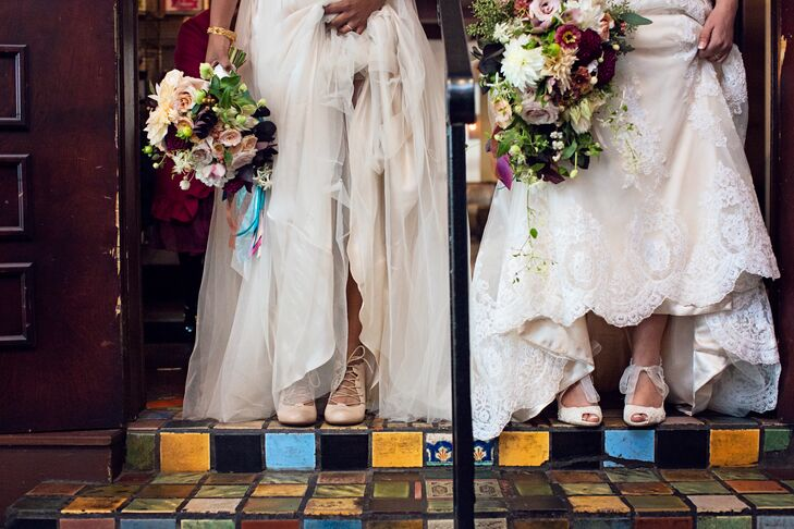 """Matching two dresses together was not an easy task,"" Laura says of choosing two separate gowns that felt similar yet not too coordinated. Nadia wore a tulle BHLDN design while Laura's ivory sheath-style dress featured scalloped lace and sheer, off-the-shoulder sleeves."
