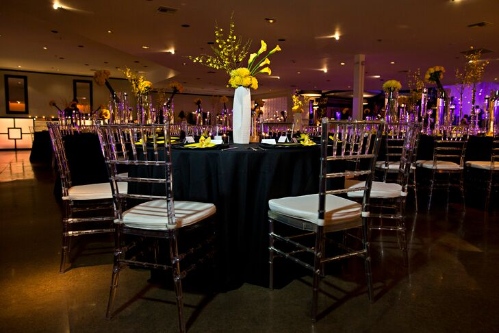 Black linen reception tablecloths and yellow orchid