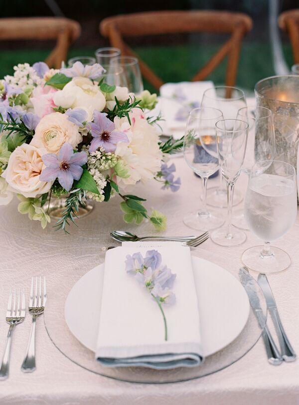 Purple wedding flower arrangements lavender sweet pea stem on white charger mightylinksfo