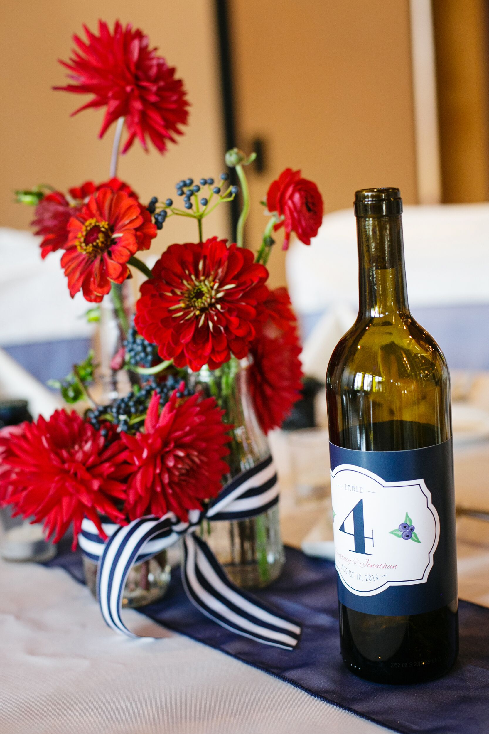 Red Centerpieces and Wine-Bottle Table Numbers