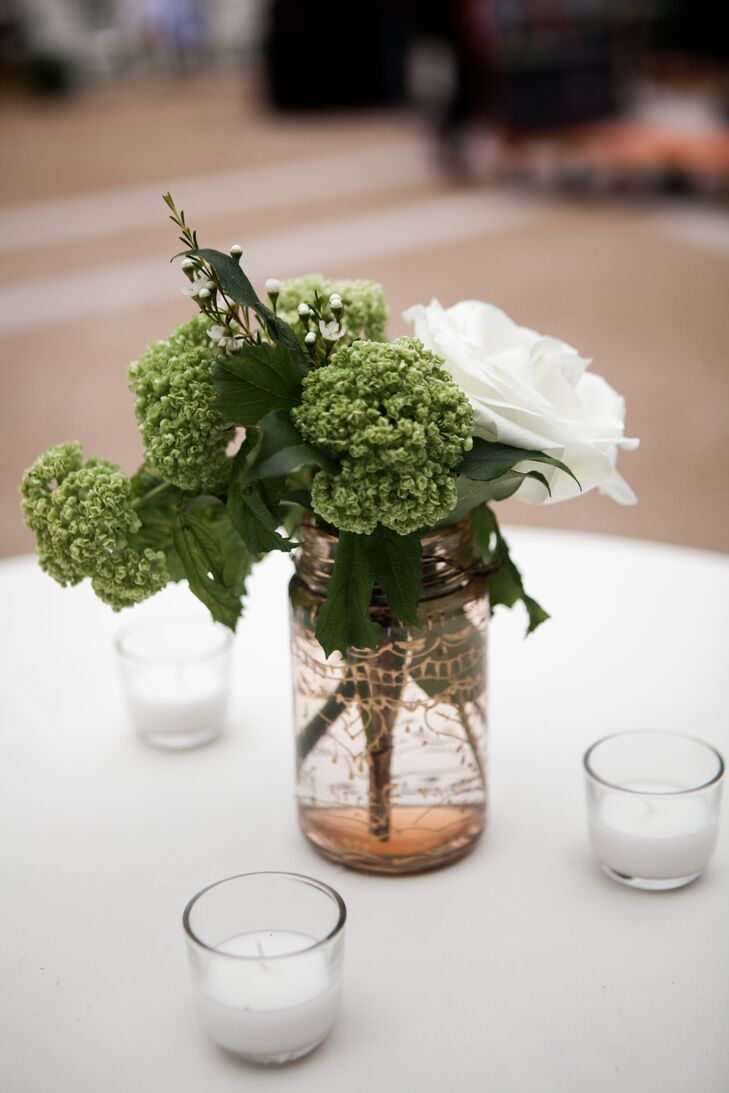 The reception and ceremony spaces incorporated mason jars with floral arrangements and candles to play up the rustic setting.