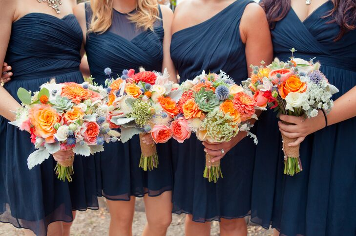 The bridesmaids wore navy blue dresses in different styles and held colorful bouquets filled with succulents, roses, chrysanthemums, Queen Anne's lace and several other flowers. The bouquets were held together with a burlap wrap.